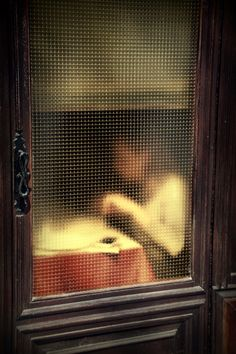 Saul Leiter (1923-2013 American) • Woman Eating Unknown Food