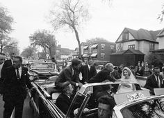 10/6/62, Minneapolis, MN- President Kennedy halts his motorcade to wish a new bride best wishes as agents who were walking with the limo gaze on- Agents Ernie Olsson, Roy Kellerman, Stu Stout, Bob Lilley, and John Campion. Senator Eugene McCarthy and Hubert Humphrey are in the limo with JFK (Vincent Palamara)