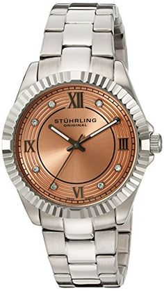 Stuhrling Original Women's 399L.221153 Symphony Lady Nautic Analog Display Swiss Quartz Silver Watch. Stainless steel round shaped case with polished coin edge bezel and protective Krysterna crystal. Pink matte finish inner dial with grey hands. Concentric circle stamped outer dial with grey applied Roman numerals and Swarovski crystal markers. Stainless steel brushed and polished finish triple row link bracelet with fold over double push button clasp. Water resistant to 330 feet (100 M)…