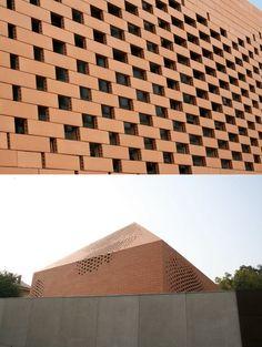 Pixelated brick skin. Pope John Paul II Chapel / Randic Turato