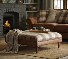 Oakland | Footstool Embrace the luxurious feel of this beautifully soft sofa, featuring wooden feet and stylish brass stud and button detailing.