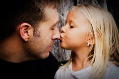 I think daddy/kid pics are just SO sweet...I think I would have her kiss his forehead instead