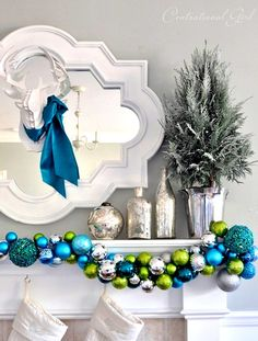 Love the colors!! Christmas décor fireplace hearth swag ToniKami Ðℯck Ʈհe HÅĿĿs Blue green & silver ornaments White contemporary