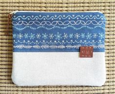 Have you ever wondered what to do with all of those decorative stitches on your sewing machine. Here is one way to embellish a small zipper bag with nothing more than the stitches on your sewing machine.