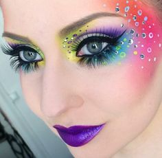 Extreme rainbow makeup with a purple lip