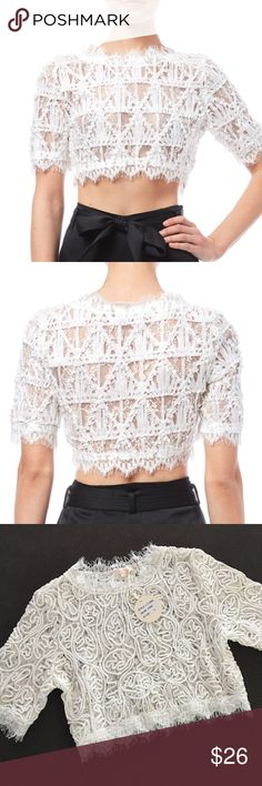 """Luxxel White Lace Crop Top New with tag. Luxxel crop top in white with beautiful detailing all around. 3/4 sleeves, has an invisible side zipper for opening. Size large, 60% cotton 40% nylon. Sheer, from shoulder down it is 14.5"""", armhole to armhole 16"""". Very lovely and perfect for summer with high waisted shorts, or a maxi skirt. Luxxel Tops Crop Tops"""