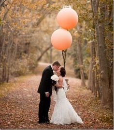 Peach balloons for bride and groom