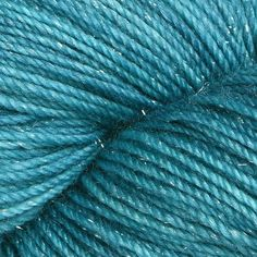 Anzula Nebula - Aqua - A tiny hint of sparkle is all you need to create something magical. That's what's on offer with Anzula Yarns' Nebula; this heavenly yarn is made of the softest premium-grade merino yarn blended with subtle metallic fibers to create a soft shimmer. Knit shawls and wraps to treasure forever.. SKU: .