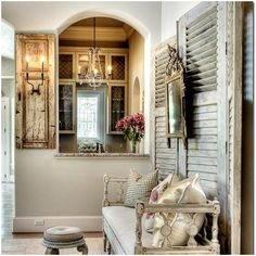 Love the reuse of the old shutters.  Room designed by Trisha Dodson