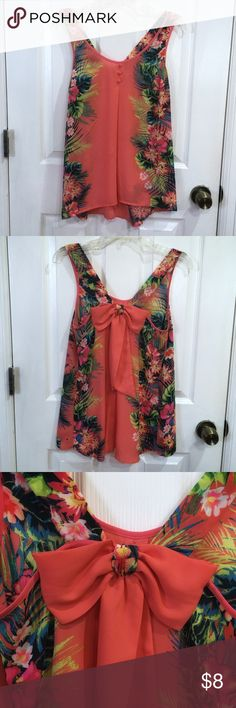 Sleeveless blouse Small sleeveless blouse with 3 buttons on front and a adorable bow in the back. Hawaiian type flowers on the side. Never worn with no tags!! Tops Blouses