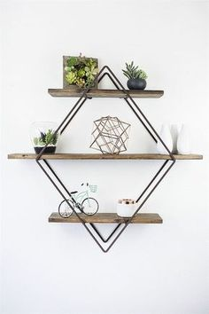 DetailsEach of our diamond book shelves are hand made from hot rolled steel rod with 3 pine wood shelves. Inspired from our love of geometric design trends, this diamond book shelf fits perfectly in any home. We decided to provided multiple color com
