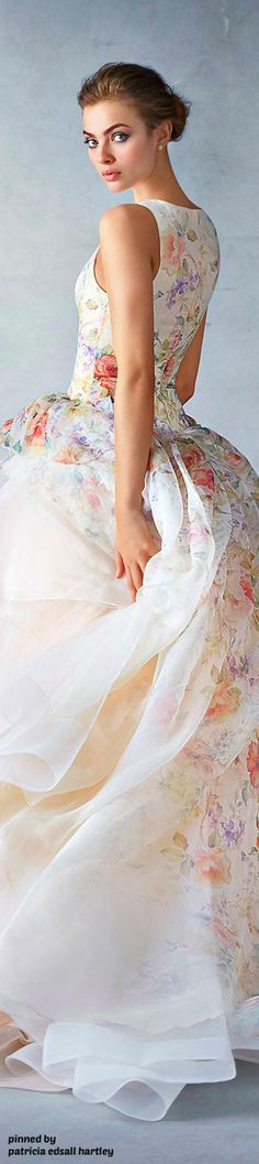 I will literally never have a reason to wear something this fancy and dramatic, but I love the idea of ivory and coral/blush florals. Maybe in a skirt?