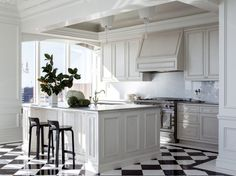 To disguise the original stark glass and steel interior architecture, Wilkinson and Black Mountain Construction/Development added an all-white kitchen, paneling and a graphic marble floor set on the diagonal.
