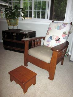 Old Morris chair with quilt covered cushion