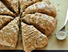 Banana Bread Scones with Brown Sugar Glaze Makes 8 scones 2 very ripe bananas (about 8 oz or 1 cup once mashed) 2-4 tablespoons milk, whole or 2% 1/2 cup (4 oz) plain yogurt, whole or 2% 2 1/2 cups (12.5 oz) all-purpose flour 4 tablespoons (1 1/2 oz) granulated sugar 2 teaspoons baking powder 1/2 teaspoons salt 1 teaspoon cinnamon 4 tablespoons (2 oz) unsalted butter 1/2 cup chopped walnuts (optional) For the glaze: 1 tablespoons (1 oz) salted butter 2 tablespoons (1 oz) milk, w...