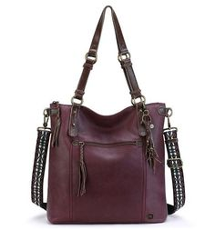 Introducing the new Ashland Tote in Cabernet. You'll stay right on trend with the warm Cabernet, perfect for fall and beyond. Can be worn two ways, as an over the shoulder or crossbody, with the detachable guitar strap. Plenty of space for all your essentials! Can be carried throughout the day.