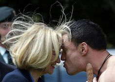 Laureen Harper, the wife of Canadian Prime Minister Stephen Harper, performs a 'Hongi' with a traditionally dressed Maori warrior during a welcoming ceremony at Government House in Auckland, November 14, 2014. REUTERS/Shane Wenzlick