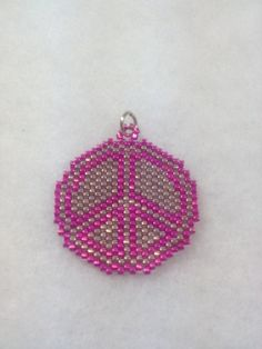 Peace Sign Brick Stitch Pendant by BeadingBeeCreations on Etsy, $15.00