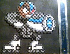 Its Cyborg, the tech-powered superhero of Teen Titans Go!, crafted from Perler beads! Hes chargin his laser in a custom pose and art style inspired