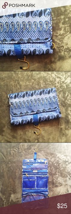 💙Super Cute Hangup Makeup Bag💙 💙Super Cute Blue Makeup Bag!💙 💟 Clip for hanging  💟 Super Cute! Lots of compartments 💟Buttons not orange, they are silver, just a reflection from my jacket lol 💟Any Questions? Feel free to ask! 😊 💟Active Posher 🛍 💟Fast Shipping on all orders 💟Happy Poshing 😁✌🏽️ Bags Cosmetic Bags & Cases