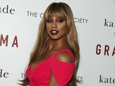 """FILE - In this Aug. 18, 2015, file photo, Laverne Cox attends a special screening of """"Grandma"""" hosted by The Cinema Society and Kate Spade at Landmark Sunshine Cinema in New York. Usher, Cox and Katie Holmes have been added to the Global Citizen Festival on Sept. 26, 2015, starring Beyonce and Pearl Jam in New York City.  (Photo by Andy Kropa/Invision/AP, File)"""