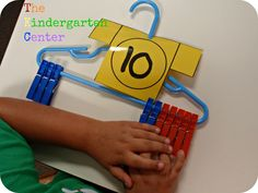 """Number Sense and Operations - Use clothes pins, a numbered paper """"t-shirt"""" and a baby clothes hanger to practice making number bonds."""