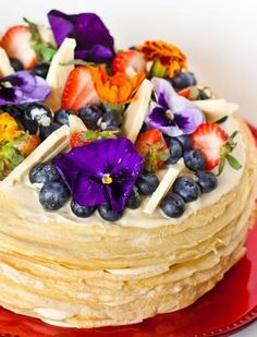 "A decadent crepe cake made with vanilla crepes and filled with light and delicious white chocolate mousse. Top the cake with fruit, chocolate and edible flowers for an elegant presentation and a major ""WOW"" factor! Watch my video recipe for step-by-step instructions! Enjoyed this cake? Please share and save it to Pinterest! And try this 'Tiramisu […]"