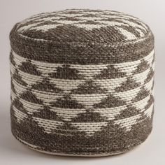 Our exclusive, plush floor pouf features a brown and cream Aztec-inspired triangle design. This comfy cushion is ideal for distinguishing small spaces or adding an extra seat for guests without taking up too much floor space.