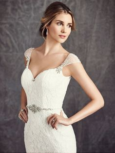 Ella Rosa Style BE282 | beaded cap sleeves that give off a swoon-worthy 1920's look | bridal accessories