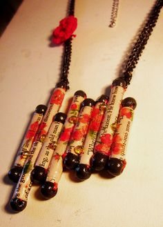 Paper bead necklace. Love the sideways attachment