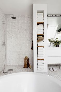 unlimited soft white towels, white mosaic tiles, tree stump