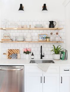 Scandinavian style kitchen tour: This white kitchen has a modern yet classic style with vintage flooring and rugs, as well as modern subway tile, white cabinets, and open shelving. Come explore this eclectic space with a full source list! New Kitchen Cabinets, Kitchen Tiles, Kitchen Flooring, White Cabinets, Upper Cabinets, Kitchen Wood, Shelves In Kitchen, Diy Cabinets, Laminate Flooring