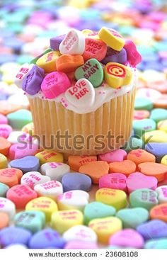 Candy Heart Cupcake surrounded by colorful candy hearts by BooHoo, via ShutterStock
