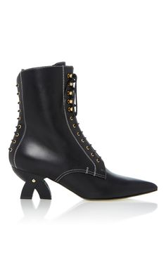 Loewe's sleek ankle boots are set on a cool, sculptural block heel. Crafted from black leather, this style has a chic pointed toe and lace-up details along the front and back. Wear yours with anything from cropped denim to dresses.