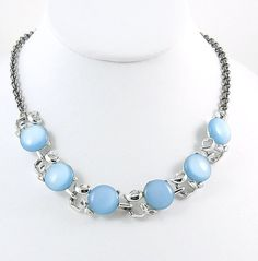 1960s Necklace has six Baby Blue Moon Glow Cabochons accented with Bright Silver tone setting, Chain and Hook Clasp. It appears that at some