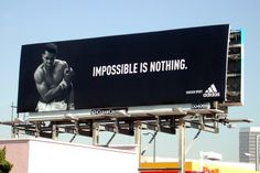 "Adidas billboard featuring Muhammad Ali. ""Impossible is nothing"""