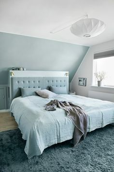 Blue and white bedroom with sloping ceiling – 12371930 – Get high-quality interior design images for your projects – rights-managed and royalty-free Rooms With Slanted Ceilings, Slanted Walls, Upstairs Bedroom, Bedroom Wall, Bedroom Decor, Slanted Ceiling Bedroom, Sloped Ceiling, Bedroom Ceiling Lights, Living Room Ornaments