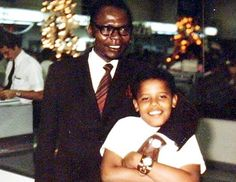 Barack Obama Sr. poses with his son in the Honolulu airport during Obama Sr.'s only visit to see his son.