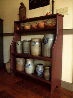 Love this shelf. I collect all kinds of stone wear. I have way to many crock bowls, pickling crocks and stone jugs. My hubby says if I bring anything else home the floor is gonna fall in ! Antique Crocks, Old Crocks, Antique Stoneware, Stoneware Crocks, Prim Decor, Country Decor, Farmhouse Decor, Red Farmhouse, Modern Farmhouse
