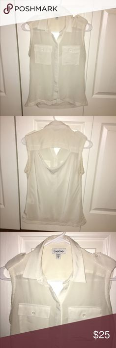 Bright White Safari Blouse Sleeveless safari style button up Bebe blouse. Has two front pockets and a cute cowl detail at back. Apparently my chest grew so doesn't fit me anymore. Worn once. bebe Tops Blouses