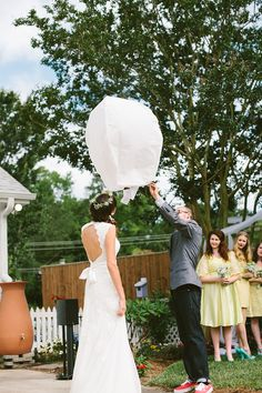 so I wanted to do this at my wedding. obviously that didn't happen since it was a sunrise shindig. you should look and see if we can do this at yours after the reception instead of sparklers. they're totally biodegradable. you light it and it takes off into the sky.