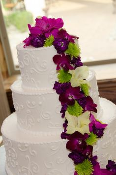 We used purple orchids, dark purple stock, purple gladiola blooms, and green button mums