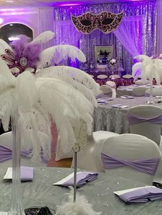 Feather centerpiece at a masquerade Quinceañera party! See more party planning . Masquerade Party Centerpieces, Masquerade Ball Party, Sweet 16 Masquerade, Feather Centerpieces, Masquerade Wedding, Masquerade Theme, Balloon Centerpieces, Wedding Centerpieces, Masquerade Ball Decorations