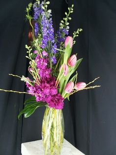Larkspur,  stock, carnations,  tulips,  and fresh willow