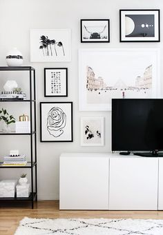 Black and white gallery wall with TV in the middle