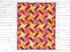 Spinning Star Sunrise Quilt Kit by Kate Colleran featuring Boundless Batiks | Craftsy