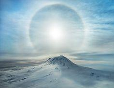 A Polar Sunbow Erupts Over an Iced Volcano