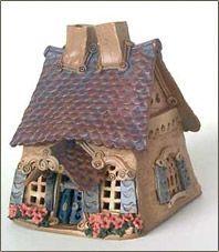 I treasure my Windy Meadows pottery houses.
