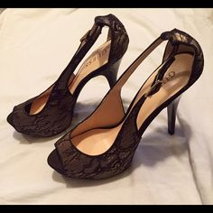 GUESS shoes Elegant high heeled, beige with a black lace. Perfect for any night on the town or quiet dinner for two. Dress to impress with these beauties for a discount price. Guess Shoes Heels