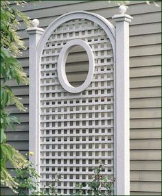 "Lattice with Oval Cut-Out - The symmetry of the horizontal/vertical lines are juxtaposed by the charming oval. Panel has a curving arched top with cap and is 8' H, 4' W. Oval cut-out is 18"" H, 12"" W. Horizontal/vertical lattice opening is 2 1/2"" sq. Lattice thickness is 5/8"" by 1 1/8"". Decorative sphere cap. Crafted in solid cellular vinyl. Allow 30"" to 36"" for burial of 4"" sq. posts. Prefinished white. Motor freight."